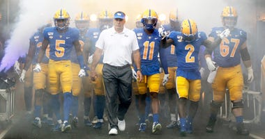 Pittsburgh Panthers head coach Pat Narduzzi (center) leads the team onto the field to play the Ohio Bobcats at Heinz Field. Pittsburgh won 20-10.