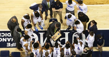 Pittsburgh Panthers head coach Jeff Capel (center) diagrams a play in the huddle during a time-out against the Clemson Tigers during the first half at the Petersen Events Center. Clemson won 62-48.