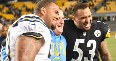 Pittsburgh Steelers center Maurkice Pouncey (53) and his brother Los Angeles Chargers center Mike Pouncey (53) after their game at Heinz Field.