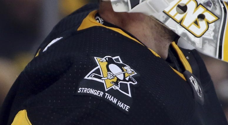 A commemorative patch honoring the victims the Tree of Life Synagogue massacre is displayed on the jersey of Pittsburgh Penguins goaltender Matt Murray (30) against the New York Islanders