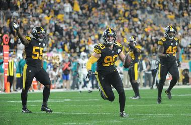 ittsburgh Steelers linebacker T.J. Watt (90) celebrates against the Miami Dolphins during the fourth quarter at Heinz Field.