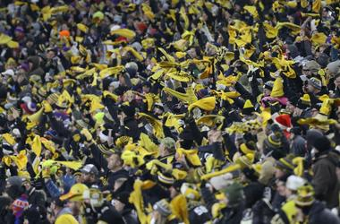 Pittsburgh Steelers fans wave terrible towels against the Buffalo Bills during the fourth quarter at Heinz Field.