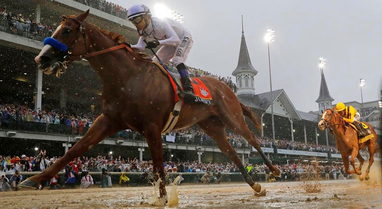 Mike Smith rides Justify to victory during the 144th running of the Kentucky Derby