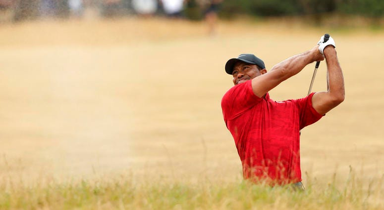 Tiger Woods of the U.S. plays out of a bunker on the 10th hole during the final round for the 147th British Open Golf championships in Carnoustie, Scotland