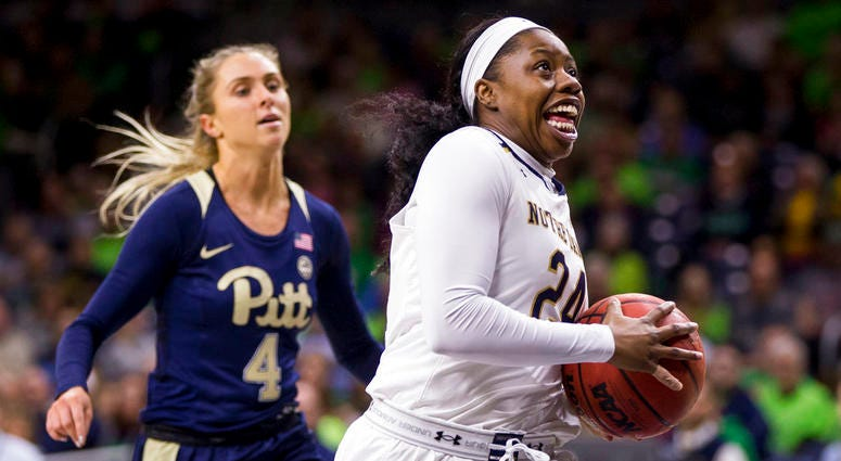 Notre Dame's Arike Ogunbowale (24) drives in on a fast break in front of Pittsburgh's Cassidy Walsh