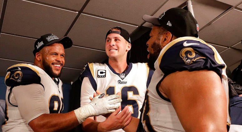 Los Angeles Rams defensive end Aaron Donald (99) Los Angeles Rams nose tackle Ndamukong Suh (93) and Los Angeles Rams quarterback Jared Goff