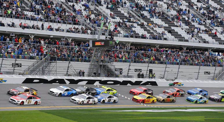 Paul Menard (21) and Kyle Busch, top left, lead the field of cars to start the NASCAR Clash auto race at Daytona International Speedway, Sunday, Feb. 10, 2019, in Daytona Beach, Fla.