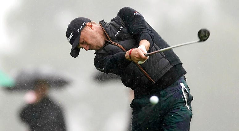 Justin Thomas hits his second shot on the 18th hole during a rain shower in the second round of the Genesis Open golf tournament at Riviera Country Club on Friday, Feb. 15, 2019, in the Pacific Palisades area of Los Angeles.