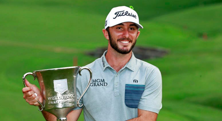 Max Homa poses with the trophy after winning the Wells Fargo Championship golf tournament at Quail Hollow Club in Charlotte, N.C., Sunday, May 5, 2019.