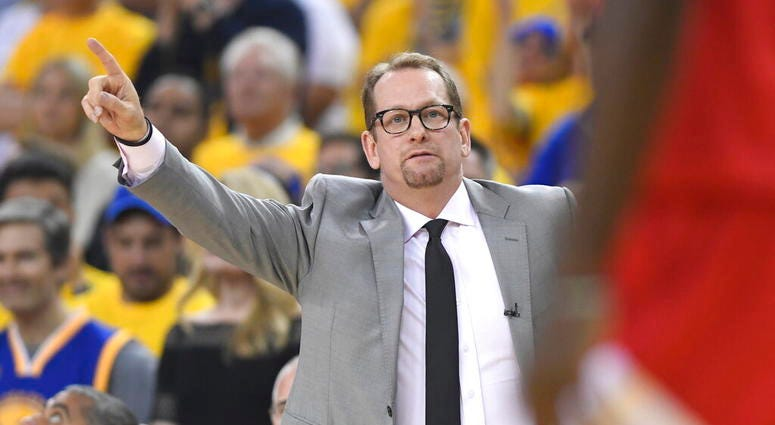 Toronto Raptors coach Nick Nurse signals during the first half against the Golden State Warriors in Game 6 of basketball's NBA Finals, Thursday, June 13, 2019, in Oakland, Calif.