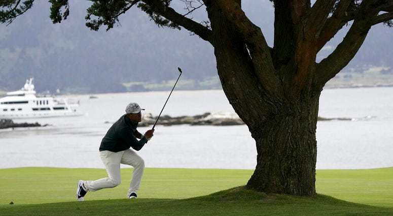 Brooks Koepka watches his shot from 18th fairway during the third round of the U.S. Open golf tournament Saturday, June 15, 2019, in Pebble Beach, Calif. (