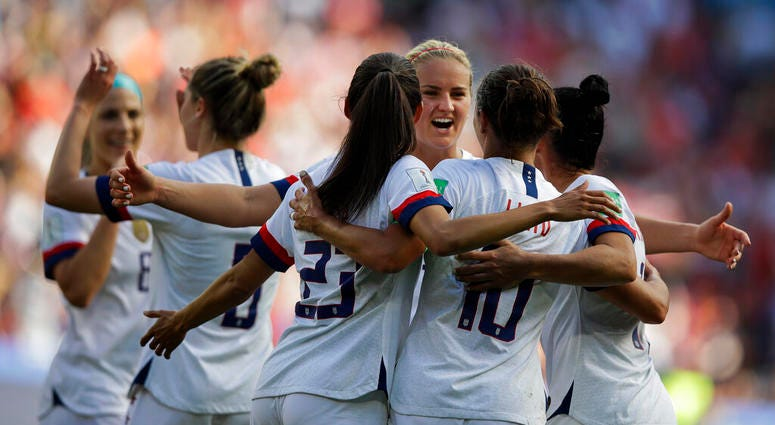 US players celebrate after teammate Carli Lloyd scored their side's third goal during the Women's World Cup Group F soccer match between United States and Chile at Parc des Princes in Paris, France, Sunday, June 16, 2019.