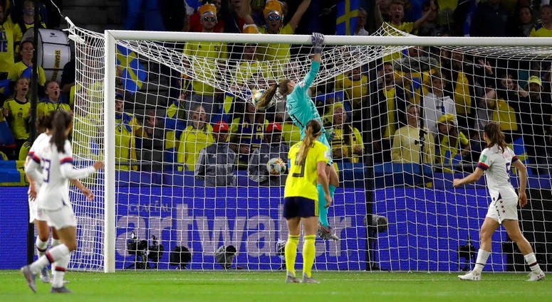 United States goalkeeper Alyssa Naeher punches the ball across the bar during the Women's World Cup Group F soccer match between Sweden and the United States at Stade Océane, in Le Havre, France, Thursday, June 20, 2019.