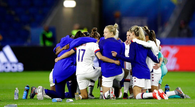 United States players embrace following their team's 2-0 win over Sweden in the Women's World Cup Group F soccer match at Stade Océane, in Le Havre, France, Thursday, June 20, 2019.