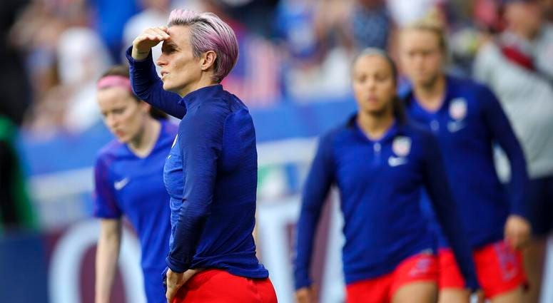 United States' Megan Rapinoe warms up before the Women's World Cup semifinal soccer match between England and the United States, at the Stade de Lyon outside Lyon, France, Tuesday, July 2, 2019.