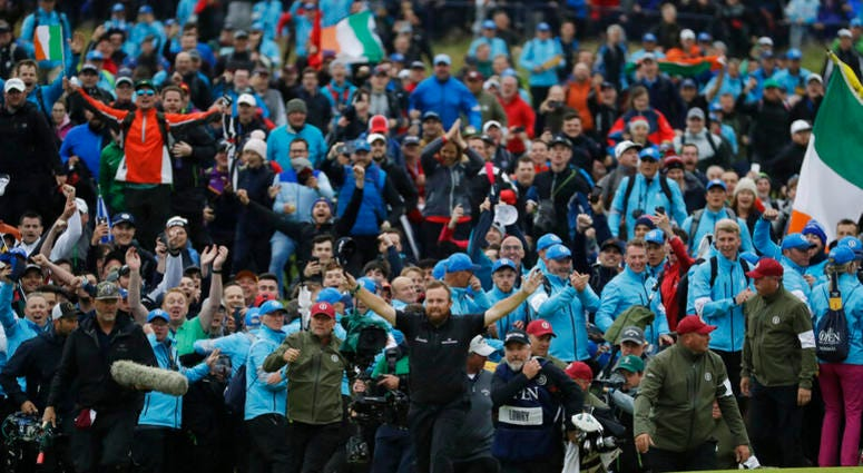 Ireland's Shane Lowry walks arms outstretched on the 18th green as he goes on to win the British Open Golf Championships at Royal Portrush in Northern Ireland, Sunday, July 21, 2019.