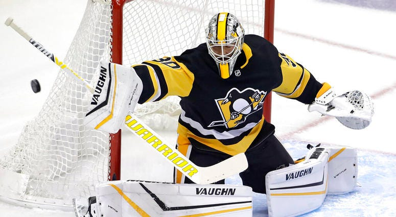 Pittsburgh Penguins goaltender Matt Murray blocks a shot during the first period of an NHL hockey game against the Winnipeg Jets in Pittsburgh, Tuesday, Oct. 8, 2019.