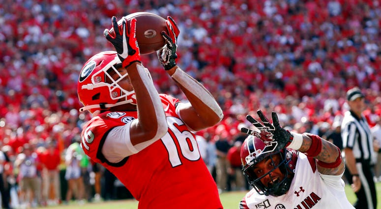 Georgia wide receiver Demetris Robertson (16) catches a pass for a touchdown as South Carolina defensive back R.J. Roderick (10) defends in the second half of an NCAA college football game Saturday, Oct. 12, 2019, in Athens, Ga.