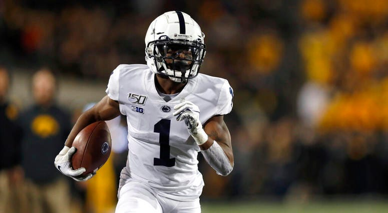 Penn State wide receiver KJ Hamler runs the ball in for a touchdown during the first half of the team's NCAA college football game against Iowa on Saturday, Oct. 12, 2019, in Iowa City, Iowa.