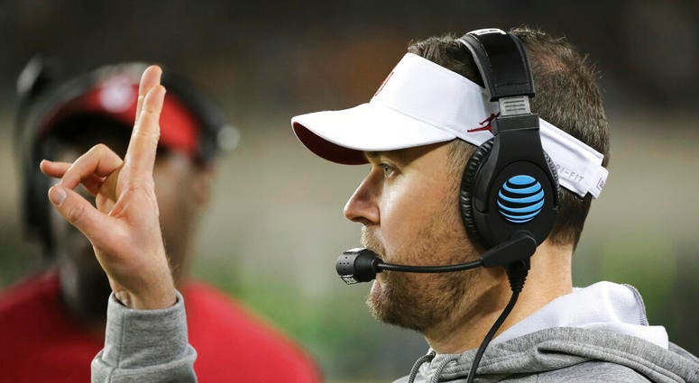 Oklahoma head coach Lincoln Riley signals in a play from the sideline during the second half of an NCAA college football game against Baylor in Waco, Texas, Saturday, Nov. 16, 2019.