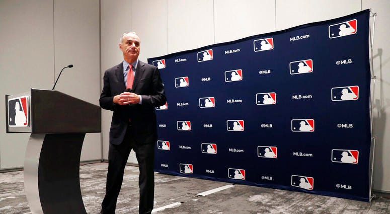 Baseball commissioner Rob Manfred steps away from the podium after speaking to the media at the owners meeting in Arlington, Texas, Thursday, Nov. 21, 2019.
