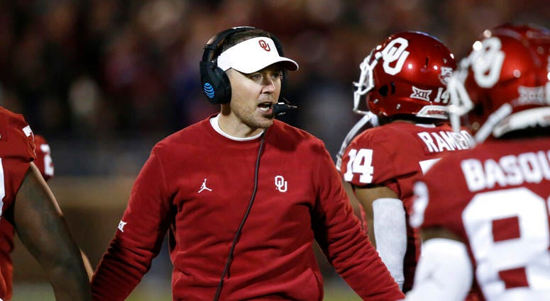 Oklahoma head coach Lincoln Riley greets players as they return to the sideline after scoring in the first half of an NCAA college football game against TCU in Norman, Okla., Saturday, Nov. 23, 2019.