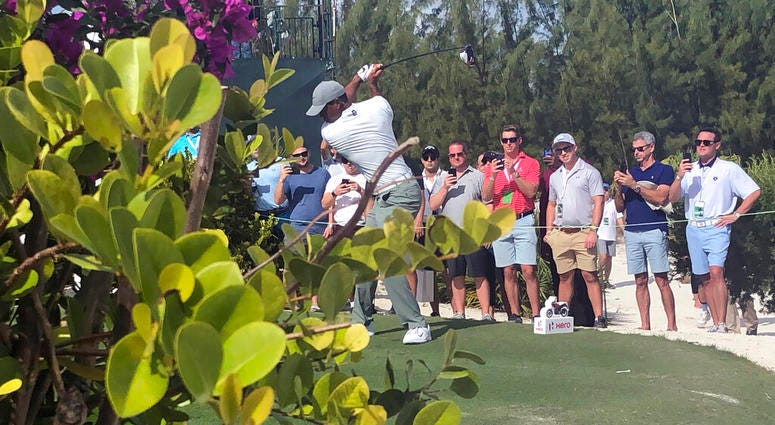 Tiger Woods hits on the par-5 11th hole on his way to an eagle at Albany Golf Club during the second round of the Hero World Challenge in Nassau, Bahamas, Thursday Dec. 5 2019. Woods shot 66.