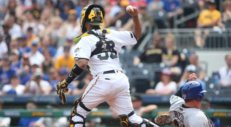 Chicago Cubs first baseman Anthony Rizzo (44) slides into the leg of Pittsburgh Pirates catcher Elias Diaz (32) causing a throwing error which allowed two runs to score during the eighth inning
