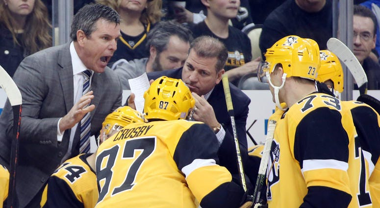 Mike Sullivan talks to his team