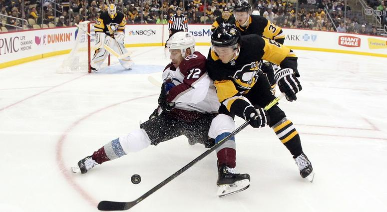 Colorado Avalanche right wing Joonas Donskoi is checked off of the puck by Pittsburgh Penguins defenseman John Marino