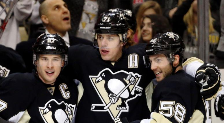 Pittsburgh Penguins center Sidney Crosby (87) and center Evgeni Malkin (71) and defenseman Kris Letang