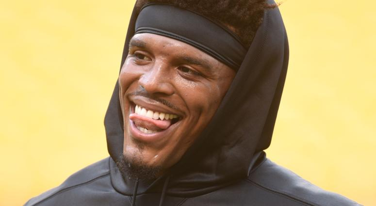 Carolina Panthers quarterback Cam Newton (1) laughs before playing the Pittsburgh Steelers at Heinz Field.