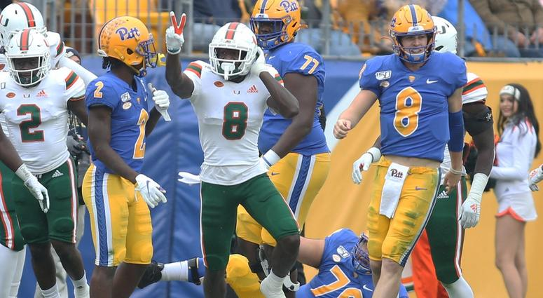 Miami Hurricanes cornerback DJ Ivey (8 left) reacts after his second interception against Pittsburgh Panthers quarterback Kenny Pickett (8 right) during the second quarter at Heinz Field.