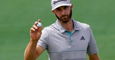 Dustin Johnson reacts on the second hole during the third round for the Masters golf tournament Saturday, April 13, 2019, in Augusta, Ga.
