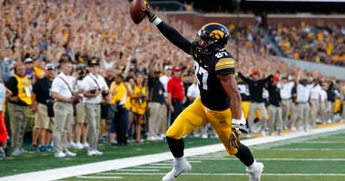 Iowa tight end Noah Fant scores on a 5-yard touchdown pass during the first half of an NCAA college football game against Northern Iowa, in Iowa City, Iowa. Fant is a possible pick in the 2019 NFL Draft.
