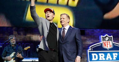 Missouri quarterback Drew Lock poses with NFL Commissioner Roger Goodell after the Denver Broncos selected Lock in the second round of the NFL football draft, Friday, April 26, 2019, in Nashville, Tenn.