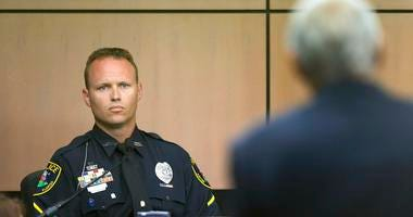 Jupiter police officer Scott Kimbark is questioned as he testifies during a motion hearing in New England Patriots owner Robert Kraft prostitution solicitation case, Wednesday, May 1, 2019, in West Palm Beach, Fla. Kimbark stopped the car containing Kraft