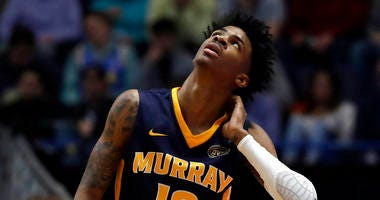 Murray State's Ja Morant (12) looks up at the scoreboard during the first half of a second round men's college basketball game against Florida State in the NCAA Tournament, Saturday, March 23, 2019, in Hartford, Conn.