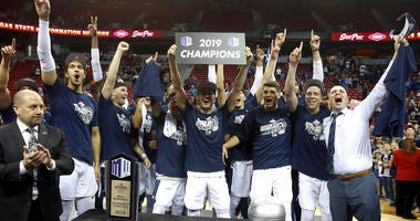 Utah State celebrates after defeating San Diego State following an NCAA college basketball game in the Mountain West Conference men's tournament championship Saturday, March 16, 2019, in Las Vegas