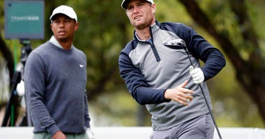 Lucas Bjerregaard, right, watches his drive on the eighth hole as Tiger Woods, left, looks on during quarterfinal play at the Dell Technologies Match Play Championship golf tournament, Saturday, March 30, 2019, in Austin, Texas. Bjerregaard won the match.