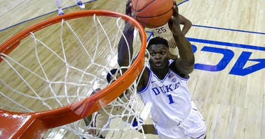 Duke's Zion Williamson (1) goes up to dunk against Florida State during the first half of the NCAA college basketball championship game of the Atlantic Coast Conference tournament in Charlotte, N.C., Saturday, March 16, 2019