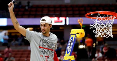 Texas Tech guard Davide Moretti holds up a piece of the net after the team's win over Gonzaga in the West Regional final in the NCAA men's college basketball tournament Saturday, March 30, 2019, in Anaheim, Calif. Texas Tech won 75-69.
