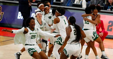 Baylor players celebrate their 72-67 win over Oregon during a Final Four semifinal of the NCAA women's college basketball tournament Friday, April 5, 2019, in Tampa, Fla.
