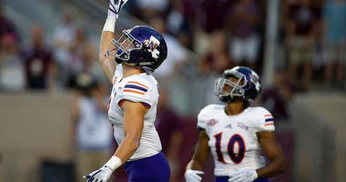 Northwestern State's Ryan Reed (8) waves for a fair catch on the opening kickoff against Texas A&M during an NCAA college football game