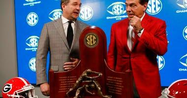 Georgia head coach Kirby Smart, left, and Alabama head coach Nick Saban