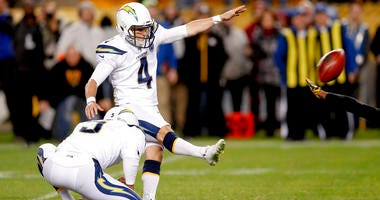 Los Angeles Chargers kicker Mike Badgley (4) hits a field goal from the hold by Donnie Jones to defeat the Pittsburgh Steelers 33-30 with no time left in an NFL football game