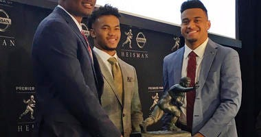 Heisman Trophy finalists, from left, Dwayne Haskins, from Ohio State, Kyler Murray, of Oklahoma, and Tua Tagovailoa, from Alabama