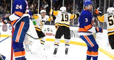 Pittsburgh Penguins center Derick Brassard (19) celebrates his goal with Penguins center Sidney Crosby