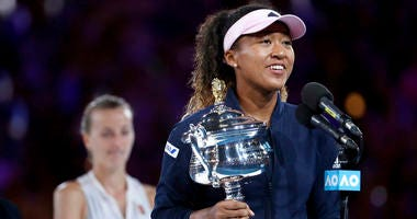 Japan's Naomi Osaka holds her trophy after defeating Petra Kvitova, left, of the Czech Republic during the women's singles final at the Australian Open tennis championships in Melbourne, Australia, Saturday, Jan. 26, 2019