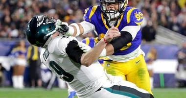 Los Angeles Rams defensive end Aaron Donald hits Philadelphia Eagles quarterback Nick Foles